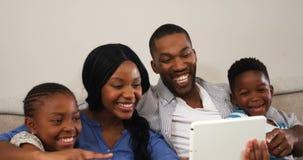 Family using digital tablet in living room 4k. Family using digital tablet in living room at home 4k stock footage