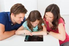 Family Using Digital Tablet Royalty Free Stock Photo