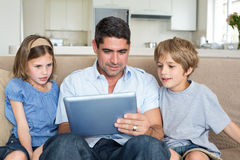Family using digital tablet together Stock Photos