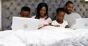 Family using electronic devices in bedroom 4k. Family using electronic devices in bedroom at home 4k stock video