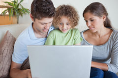 Family using a laptop Stock Photography
