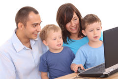 Family using laptop Stock Image