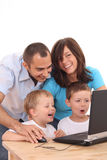 Family using laptop Royalty Free Stock Photography