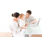 Family using laptop Royalty Free Stock Photo