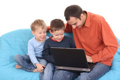 Family using laptop Royalty Free Stock Photos