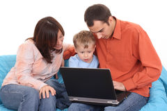 Family using laptop Stock Images