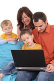 Family using laptop Royalty Free Stock Image