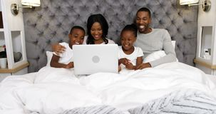 Family using laptop in bedroom 4k. Family using laptop in bedroom at home 4k stock footage