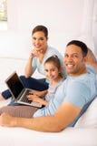 Family using laptop computer Royalty Free Stock Photos