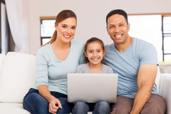 Family using laptop computer. Portrait of happy family using laptop computer at home Stock Photo