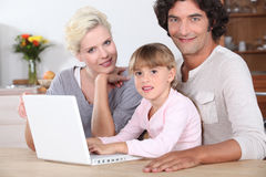 Family using a laptop computer Royalty Free Stock Image
