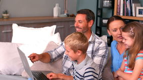 Family using laptop on couch. At home stock footage