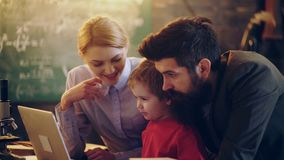 Family using laptop at home. Happy young family watching cartoon on laptop together. Happy family time. Family concept. Family using laptop at home. Happy young stock footage