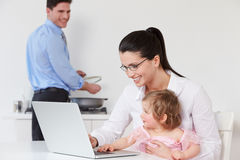 Family Using Laptop At Home Royalty Free Stock Photography
