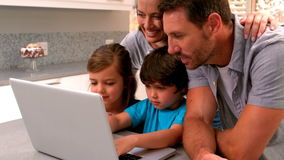 Family using laptop in kitchen. At home stock footage