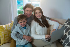 Family using laptop on sofa. At home Stock Photos