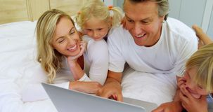 Family using laptop together in bedroom 4k. Family using laptop together in bedroom at home 4k stock footage