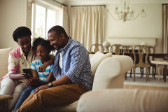 Family using mobile phone in living room royalty free stock photos