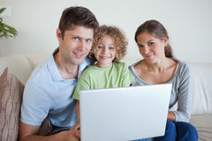 Family using a notebook Royalty Free Stock Images