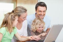 Family using notebook in the kitchen Stock Photography