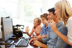 Family using skype in home office Stock Images