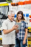 Family Using Tablet Computer In Hardware Shop Stock Image