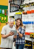 Family Using Tablet Computer In Hardware Store Royalty Free Stock Image