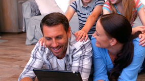 Family using tablet in living room stock footage