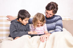 Family using tablet pc device Royalty Free Stock Images