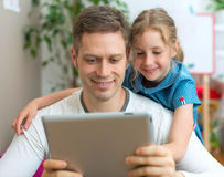 Family using tablet pc at home. Stock Photo