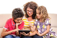 Happy Family using tablet pc Royalty Free Stock Photos