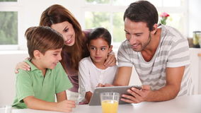 Family using a tablet pc together Stock Photo