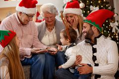 Family using tablet, spending Christmas time together royalty free stock photography