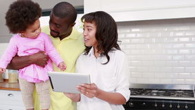 Family using tablet together at home stock footage