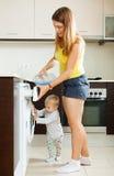 Family using washing machine Stock Photography