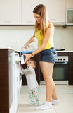 Family using washing machine Royalty Free Stock Photography