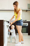 Family using washing machine with laundry Royalty Free Stock Images