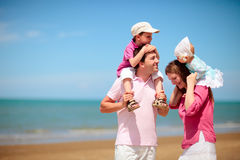 Family vacation. Young happy family with two kids on beach vacation Stock Images