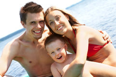 Family on vacation. Photo of smiling family on summer vacation looking at camera Stock Image