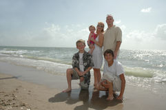 Family Vacation. A family portrait. An american family on the shore of a beach with seagulls behind them stock photo