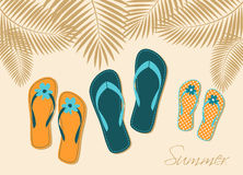 Family Vacation. Illustration of three pairs of flip-flops on the beach. Family summer vacation concept Stock Photo