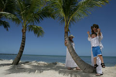Family Vacation. A mother lifting up her boy having fun on their vacation in Florida Stock Photography