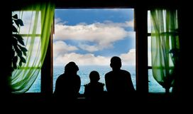 Family on vacation. Silhouettes on sky background Stock Photo