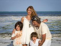 Family on vacation, beach at low tide, green sea, Zanzibar stock photography