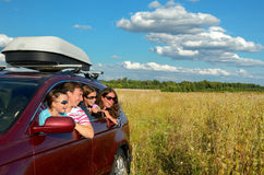 Family vacation, car trip. On summer, happy parents travel with kids and having fun, car insurance concept Royalty Free Stock Photos