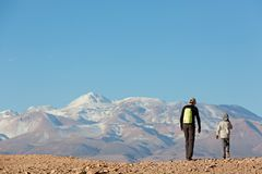 Family vacation in chile. Back view of family of two, father and son, hiking and walking together enjoying valle de la muerte in atacama desert, chile, healthy Royalty Free Stock Photography