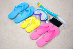 Family vacation concept - flip flops, diving mask and phone on t Royalty Free Stock Image