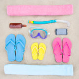 Family vacation concept - summer beach accessories on the sand. Family vacation concept - close up of summer beach accessories on the sand royalty free stock images