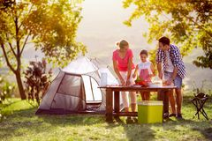 Family on vacation cut vegetables royalty free stock photography