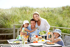 Family on vacation eating outdoors. Family on vacation eating lunch outdoors smiling to camera stock images